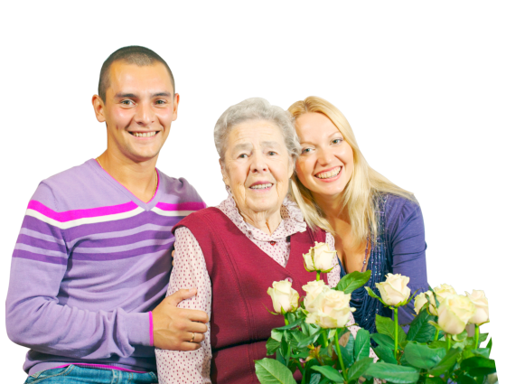Senior and her grandchildren standing next to a bouquet of flowers