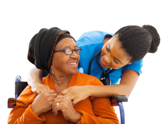 Nurse hugging a senior sitting on a wheelchair